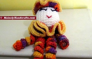Spiral Doll - Colorful Clown - Clown Doll - spiralling arms and legs - purple, orange, yellow, red